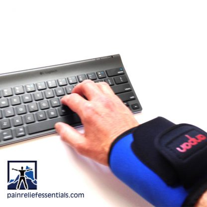 typing with a cordless infrared heating wrist wrap on